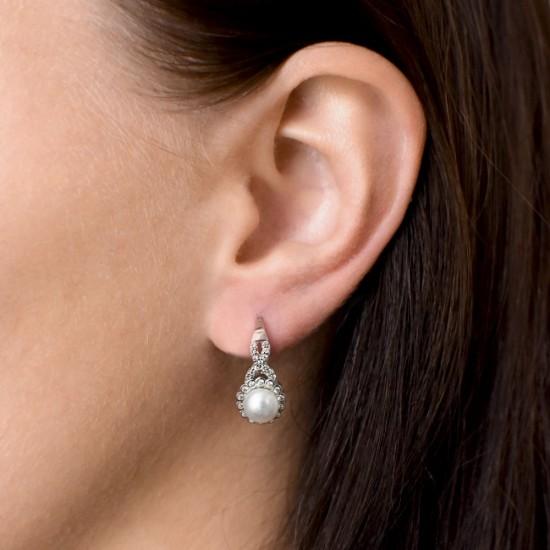 Stříbrné náušnice visací s bílou říční perlou 21049.1